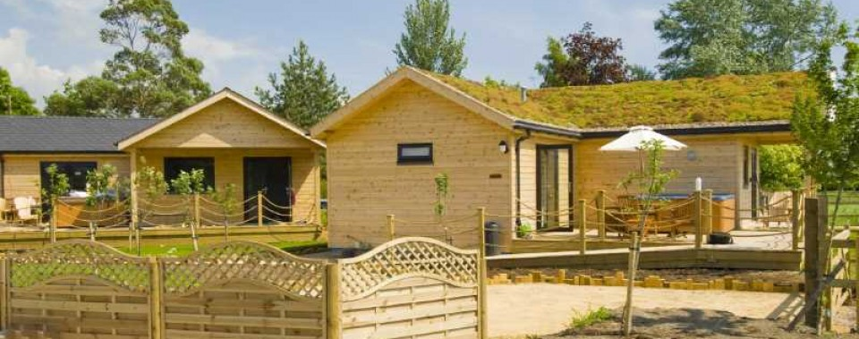 LOG CABINS IN ORCHARD  Eco friendly log cabins - all centrally heated.
